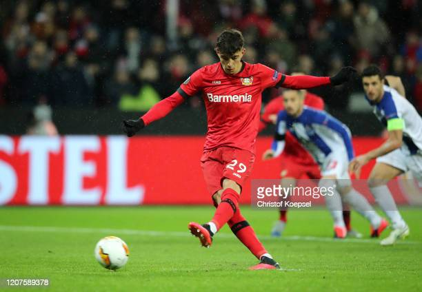Kai Havertz of Bayer 04 Leverkusen scores his teams second goal from a penalty during the UEFA Europa League round of 32 first leg match between...