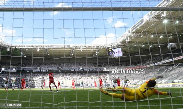 Kai Havertz of Bayer 04 Leverkusen scores his team's second goal from the penalty spot past Yann Sommer of of Borussia Moenchengladbach during the...