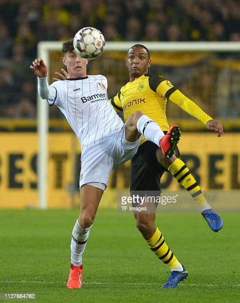 Kai Havertz of Bayer Leverkusen and Abdou Diallo of Borussia Dortmund battle for the ball during the Bundesliga match between Borussia Dortmund and...