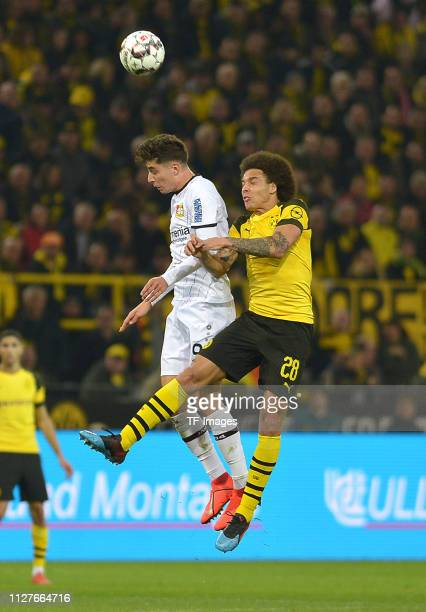 Kai Havertz of Bayer Leverkusen and Axel Witsel of Borussia Dortmund battle for the ball during the Bundesliga match between Borussia Dortmund and...