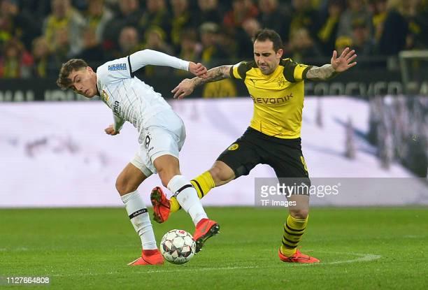 Kai Havertz of Bayer Leverkusen and Paco Alcacer of Borussia Dortmund battle for the ball during the Bundesliga match between Borussia Dortmund and...