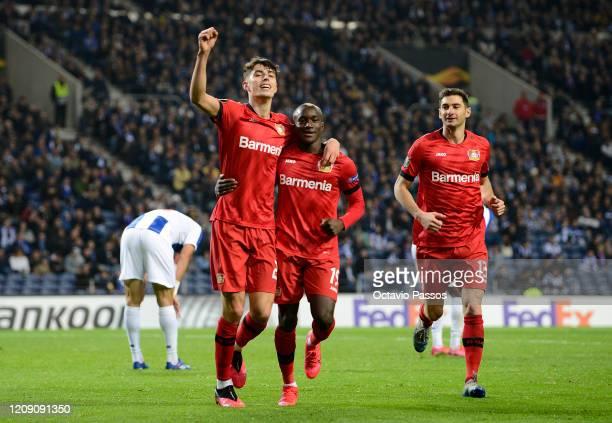 Kai Havertz of Bayer Leverkusen celebrates after scoring his sides third goal with Moussa Diaby during the UEFA Europa League round of 32 second leg...