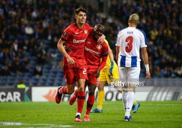 Kai Havertz of Bayer Leverkusen celebrates after scoring his sides third goal with Moussa Diaby during the UEFA Europa League round of 32 second leg...