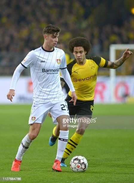 Kai Havertz of Bayer Leverkusen controls the ball and Axel Witsel of Borussia Dortmund looks on during the Bundesliga match between Borussia Dortmund...
