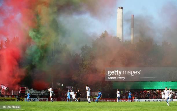 Kai Havertz of Bayer Leverkusen in action while Bayer Leverkusen let of flares during the DFB Cup match between 1 CfR Pforzheim and Bayer Leverkusen...