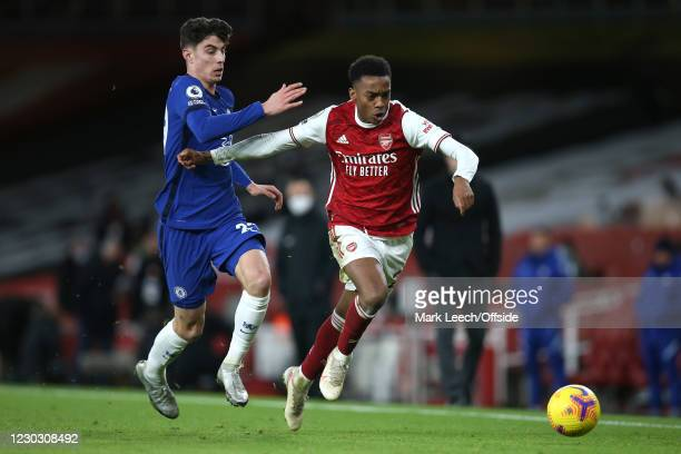 Kai Havertz of Chelsea and Joe Willock of Arsenal during the Premier League match between Arsenal and Chelsea at Emirates Stadium on December 26,...
