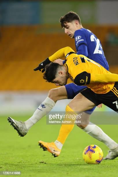 Kai Havertz of Chelsea and Pedro Neto of Wolverhampton Wanderers during the Premier League match between Wolverhampton Wanderers and Chelsea at...