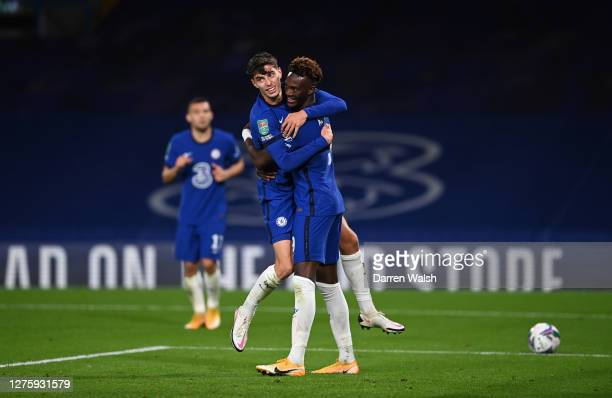 Kai Havertz of Chelsea celebrates after scoring his sides fourth goal with teammate Tammy Abraham during the Carabao Cup third round match between...