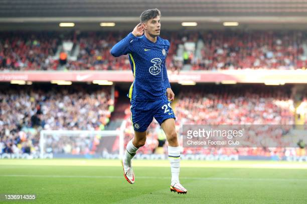 Kai Havertz of Chelsea celebrates after scoring their sides first goal during the Premier League match between Liverpool and Chelsea at Anfield on...