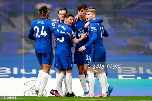 Kai Havertz of Chelsea celebrates with Ben Chilwell, Billy Gilmour and Timo Werner after scoring their side's first goal during the Premier League...