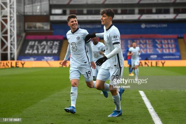 Kai Havertz of Chelsea celebrates with Mason Mount after scoring their team's first goal during the Premier League match between Crystal Palace and...