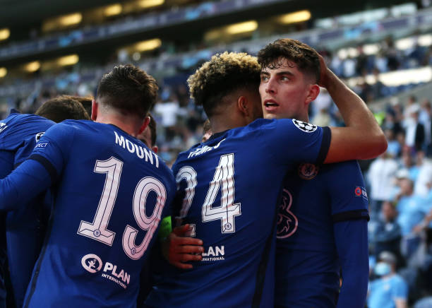 Kai Havertz of Chelsea celebrates with team mate Reece James after scoring their side's first goal during the UEFA Champions League Final between...