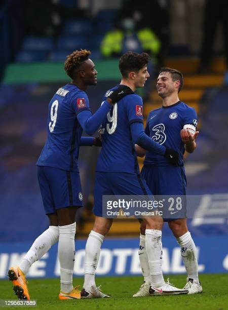 Kai Havertz of Chelsea celebrates with team mates Tammy Abraham and Cesar Azpilicueta after scoring their side's fourth goal during the FA Cup Third...