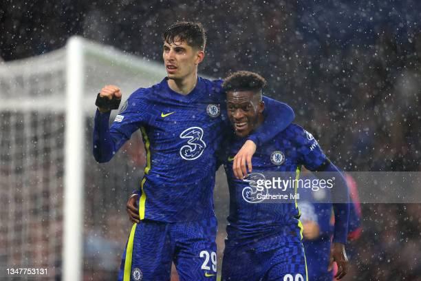 Kai Havertz of Chelsea celebrates with teammate Callum Hudson-Odoi after scoring their team's third goal during the UEFA Champions League group H...
