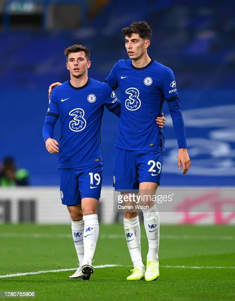 Kai Havertz of Chelsea celebrates with teammate Mason Mount after scoring his sides third goal during the Premier League match between Chelsea and...