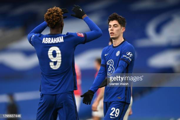 Kai Havertz of Chelsea celebrates with teammate Tammy Abraham after scoring their team's fourth goal during the FA Cup Third Round match between...
