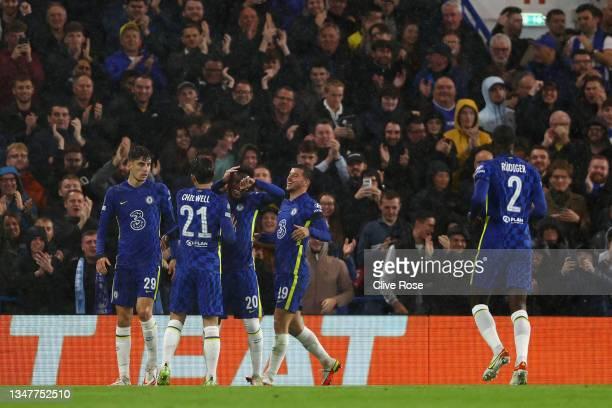 Kai Havertz of Chelsea celebrates with teammates Ben Chilwell, Callum Hudson-Odoi and Mason Mount after scoring their team's third goal during the...