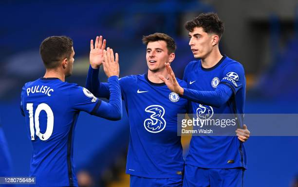Kai Havertz of Chelsea celebrates with teammates Mason Mount and Christian Pulisic after scoring his team's third goal during the Premier League...