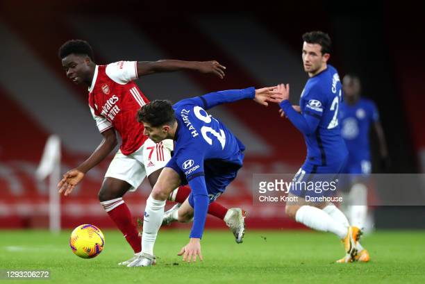 Kai Havertz of Chelsea FC and Bukayo Saka of Arsenal collide during the Premier League match between Arsenal and Chelsea at Emirates Stadium on...