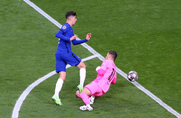 Kai Havertz of Chelsea FC gets tackled by Ederson Moraes of Manchester City during the UEFA Champions League Final between Manchester City and...