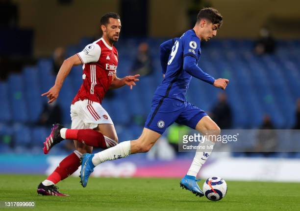 Kai Havertz of Chelsea gets past Pablo Mari of Arsenal during the Premier League match between Chelsea and Arsenal at Stamford Bridge on May 12, 2021...