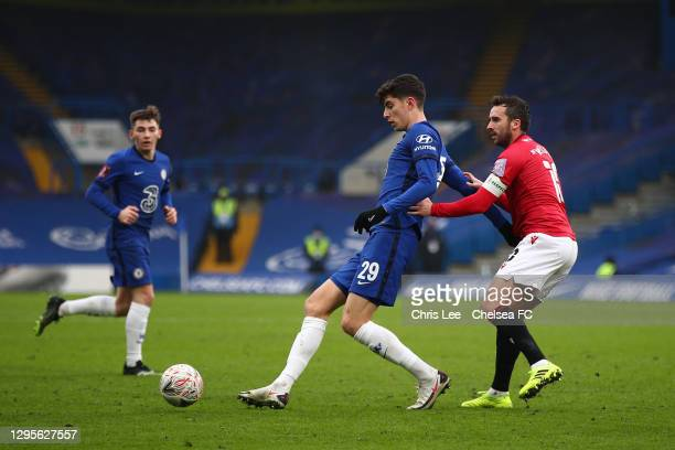 Kai Havertz of Chelsea holds off Aaron Wildig of Morecambe during the FA Cup Third Round match between Chelsea and Morecambe at Stamford Bridge on...