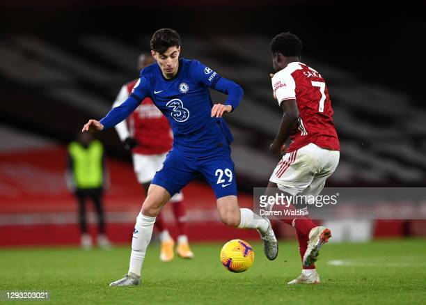 Kai Havertz of Chelsea is challenged by Bukayo Saka of Arsenal during the Premier League match between Arsenal and Chelsea at Emirates Stadium on...