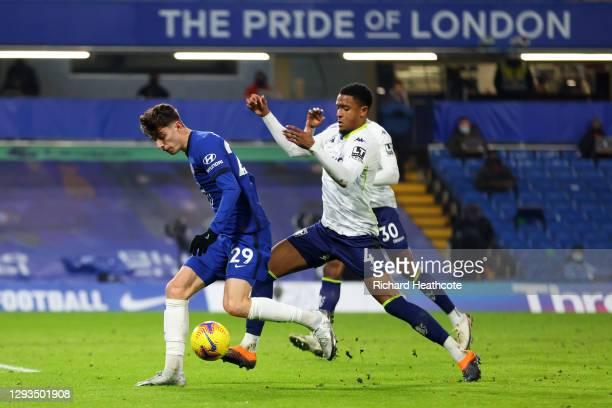 Kai Havertz of Chelsea is challenged by Ezri Konsa of Aston Villa during the Premier League match between Chelsea and Aston Villa at Stamford Bridge...