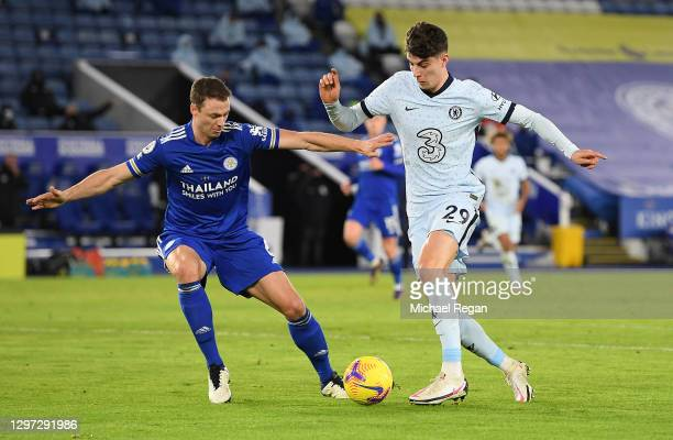 Kai Havertz of Chelsea is challenged by Jonny Evans of Leicester City during the Premier League match between Leicester City and Chelsea at The King...