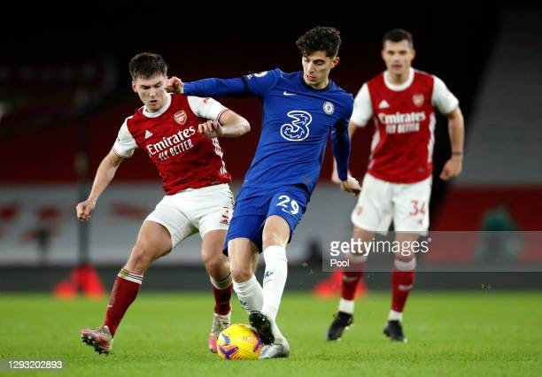 Kai Havertz of Chelsea is challenged by Kieran Tierney of Arsenal during the Premier League match between Arsenal and Chelsea at Emirates Stadium on...