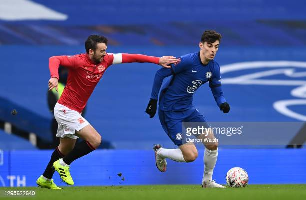 Kai Havertz of Chelsea is challenged by Sam Lavelle of Morecambe during the FA Cup Third Round match between Chelsea and Morecambe at Stamford Bridge...