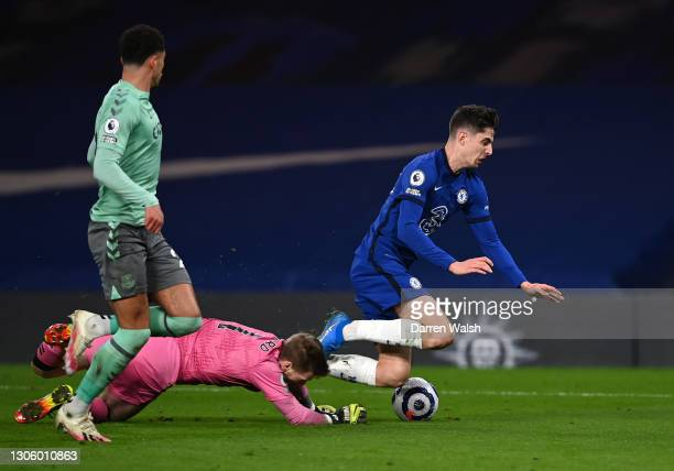 Kai Havertz of Chelsea is fouled by Jordan Pickford of Everton in the box leading to a penalty decision during the Premier League match between...