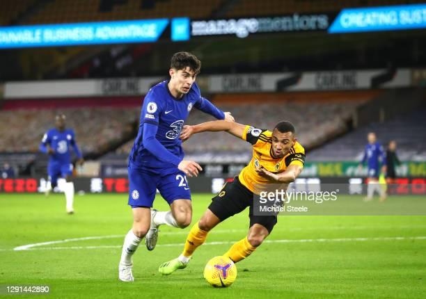 Kai Havertz of Chelsea is put under pressure by Fernando Marcal of Wolverhampton Wanderers during the Premier League match between Wolverhampton...