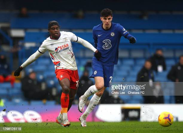 Kai Havertz of Chelsea looks to break past Pelly-Ruddock Mpanzu of Luton Town during The Emirates FA Cup Fourth Round match between Chelsea and Luton...