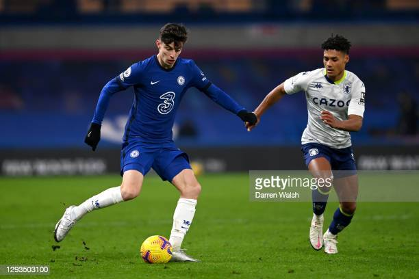 Kai Havertz of Chelsea on the ball whilst under pressure from Ollie Watkins of Aston Villa during the Premier League match between Chelsea and Aston...