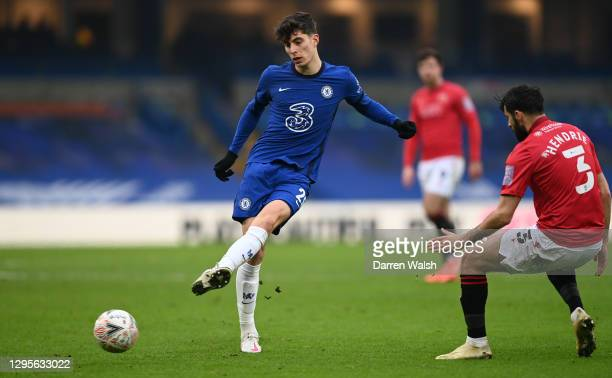 Kai Havertz of Chelsea passes the ball under pressure from Stephen Hendrie of Morecambe during the FA Cup Third Round match between Chelsea and...
