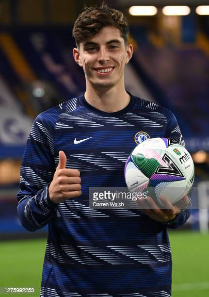 Kai Havertz of Chelsea poses for a photograph with the match ball after scoring a hat trick during the Carabao Cup third round match between Chelsea...