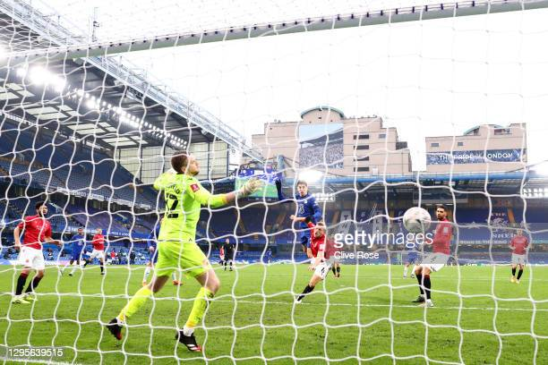 Kai Havertz of Chelsea scores their team's fourth goal past Mark Halstead of Morecambe during the FA Cup Third Round match between Chelsea and...