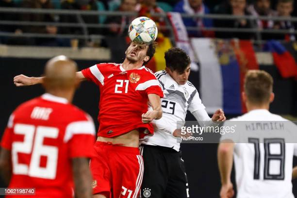 Kai Havertz of Germany and Aleksandr Erokhin of Russia vie for a header during the international friendly match between Germany and Russia on...