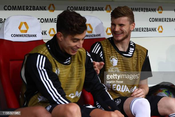 Kai Havertz of Germany and Tom Werner sit on the bench during the UEFA Euro 2020 Qualifier match between Germany and Estonia at Opel Arena on June...