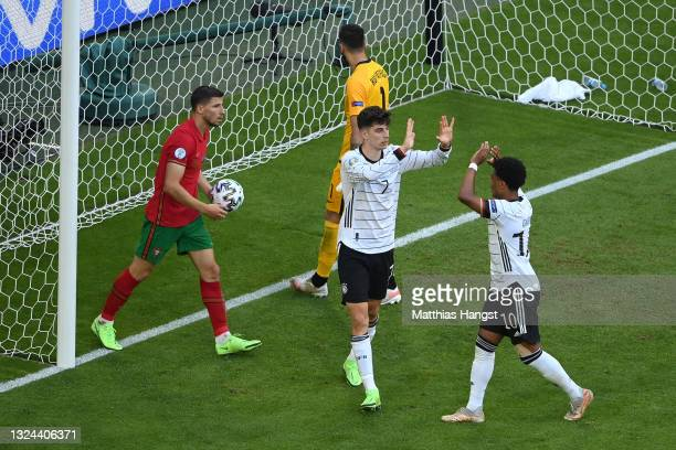 Kai Havertz of Germany celebrates with Serge Gnabry after scoring their side's third goal during the UEFA Euro 2020 Championship Group F match...