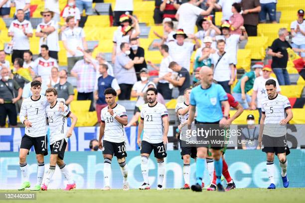 Kai Havertz of Germany celebrates with Thomas Mueller after their side's first goal credited as and own goal scored by Ruben Dias of Portugal during...