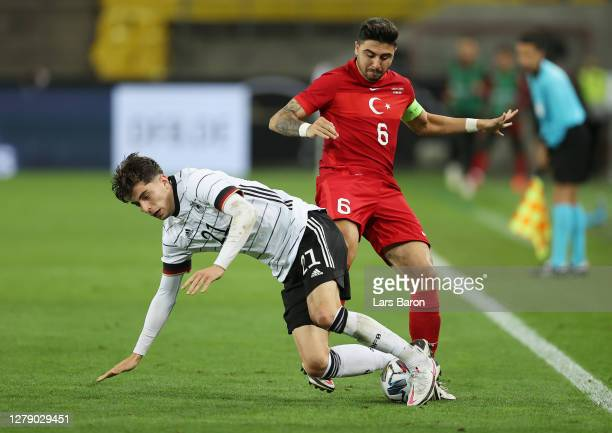 Kai Havertz of Germany is challenged by Ozan Tufan of Turkey during the international friendly match between Germany and Turkey at...