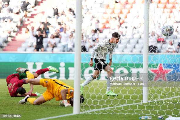 Kai Havertz of Germany looks on as Ruben Dias of Portugal scores an own goal for Germany's opening goal past goalkeeper Rui Patricio of Portugal...