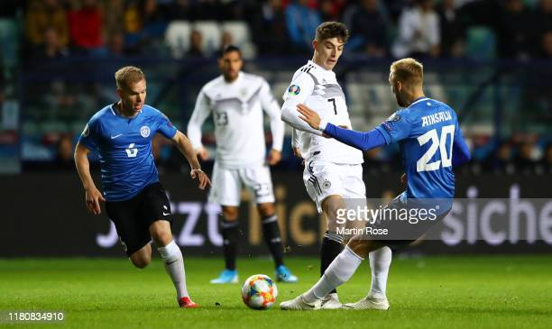 Kai Havertz of Germany passes the ball past Ilja Antonov and Mihkel Ainsalu of Estonia during the UEFA Euro 2020 qualifier between Estonia and...