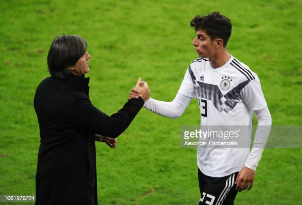 Kai Havertz of Germany shake hands after his substitution with Head coach Joachim Loew of Germany during the International Friendly match between...