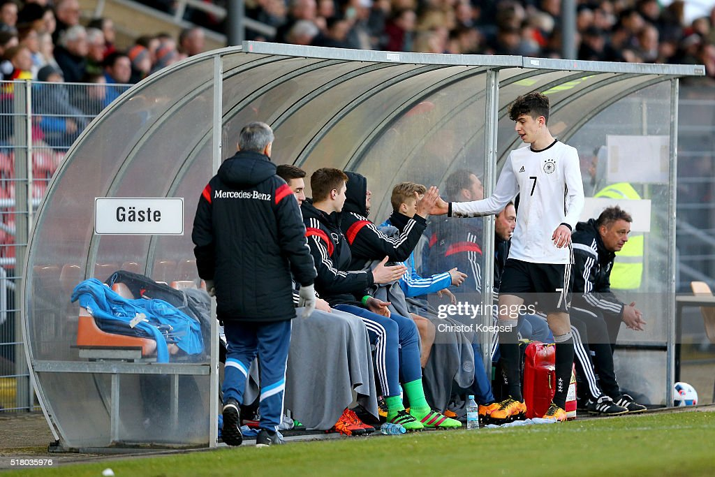 Kai Havertz of Germany shake hands woth the substitution players during the U17 Euro Qualification match between Germany and Netherlands at Paul Janes Stadium on March 29, 2016 at Esprit-Arena in Duesseldorf, Germany.