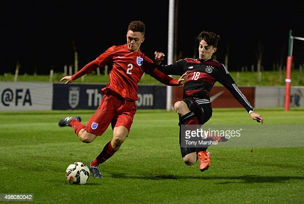 Kai Havertz of Germany tackles Jordan Williams of England during the U17s International Friendly match between England U17 and Germany U17 at St...