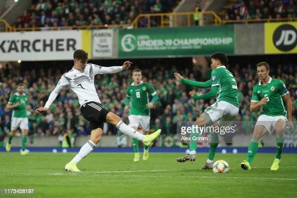 Kai Havertz of Germany takes a shot on the goal against Jamal Lewis of Northern Ireland during the UEFA Euro 2020 qualifier match between Northern...