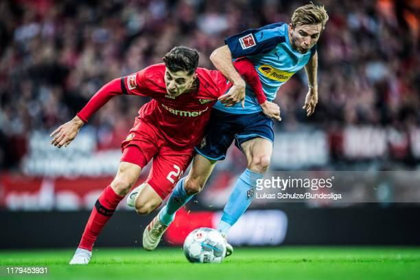 Kai Havertz of Leverkusen and Christoph Kramer of Mönchengladbach in action during the Bundesliga match between Bayer 04 Leverkusen and Borussia...